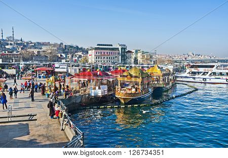 ISTANBUL TURKEY - JANUARY 21 2015: The Eminonu promenade boasts perfect floating fish restaurants decorated in Eastern style on January 21 in Istanbul.