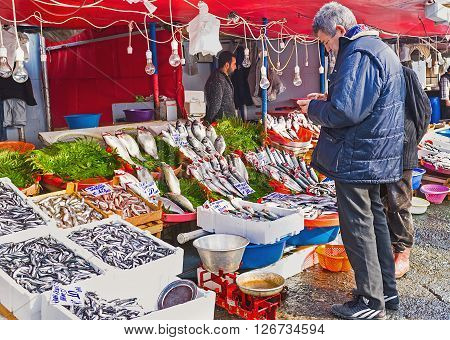 ISTANBUL TURKEY - JANUARY 21 2015: The central fish market next to Galata bridge offers the wide range of the fish from Bosphorus and Golden Horn Bay on January 21 in Istanbul.
