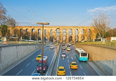 ISTANBUL TURKEY - JANUARY 21 2015: The Ataturk Boulevard passes under the arches of the ancient Valens Aqueduct on January 21 in Istanbul.