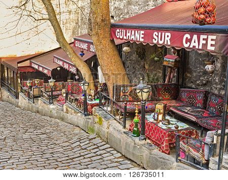 ISTANBUL TURKEY - JANUARY 21 2015: The traditional Turkish cafe with the cozy alcoves and decorated trestle-beds located on Sogukcesme street on he half-way to the Topkapi Palace on January 21 in Istanbul.