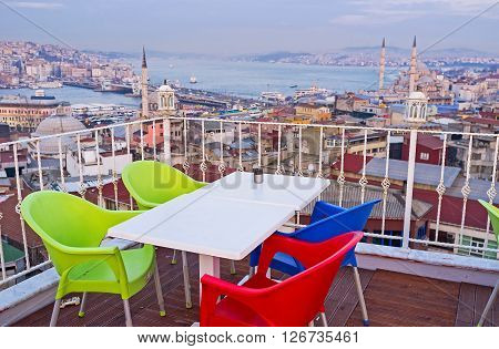 The Fatih district boasts many cafes located on the of the Third Hill with romantic terraces on the roofs overlooking the city and Golden Horn Bay Istanbul Turkey.