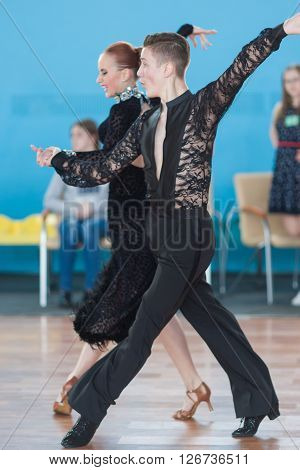 Minsk Belarus -April 3 2016: Stahovich Timofey and Grinchik Anna Perform Juvenile-2 Latin-American Program on IDSA Championship Kinezis Star Cup - 2016 in April 3 2016 in Minsk Republic of Belarus