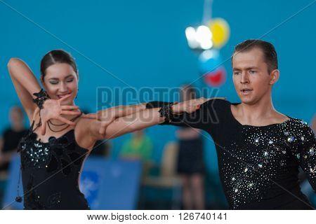 Minsk Belarus -April 3 2016: Babushin Anton and Milovidova Yana Perform Youth Latin-American Program on IDSA Championship Kinezis Star Cup - 2016 in April 3 2016 in Minsk Republic of Belarus