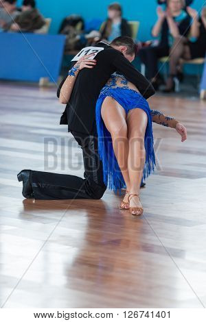 Minsk Belarus -April 3 2016: Belyavskiy Vladislav and Belan Dariya Perform Youth Latin-American Program on IDSA Championship Kinezis Star Cup - 2016 in April 3 2016 in Minsk Republic of Belarus