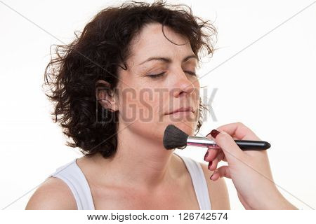 Middle-aged Model, Which Is Applied Makeup. Makeup Artist At Work.