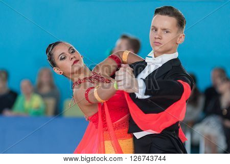Minsk Belarus -April 3 2016: Ksenzhik Pavel and Stanislavchik Mariya Perform Youth-2 Standard Program on the IDSA Championship Kinezis Star Cup in April 3 2016 in Minsk Republic of Belarus