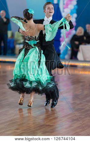 Minsk Belarus -April 3 2016: Zelenskiy Ivan and Lantuhova Anna Perform Youth-2 Standard Program on the IDSA Championship Kinezis Star Cup in April 3 2016 in Minsk Republic of Belarus