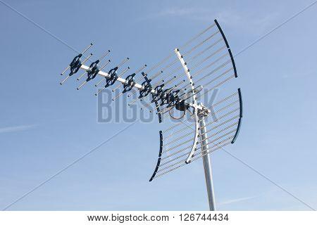 UHF Antenna isolated on blue sky background.