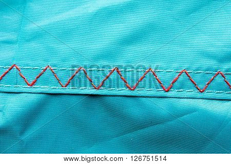 Thread stitching on a camping tent closeup.