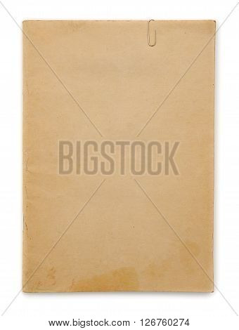 Vintage yellow paper with clip at white background