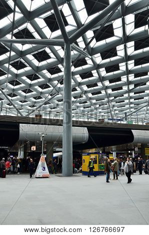 The Hague Netherlands - May 8 2015: Travelers at central Station of The Hague Netherlands on May 8 2015. The station is the largest railway station in The Hague.