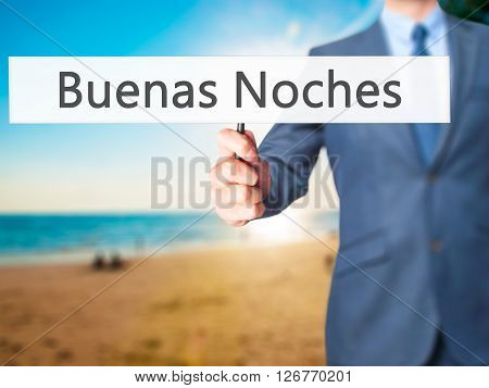 Buenas Noches (good Night In Spanish) - Businessman Hand Holding Sign