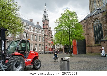 The Hague Netherlands - May 8 2015: People at Grote of Sint-Jacobskerk (Big Church). Grote of Sint-Jacobskerk is a landmark Protestant church in The Hague Netherlands.