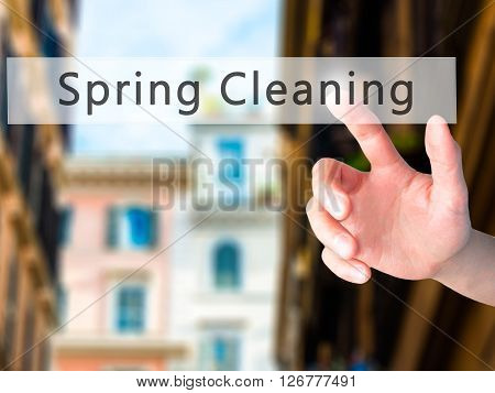 Spring Cleaning - Hand Pressing A Button On Blurred Background Concept On Visual Screen.