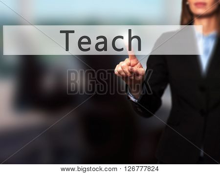 Teach - Businesswoman Hand Pressing Button On Touch Screen Interface.