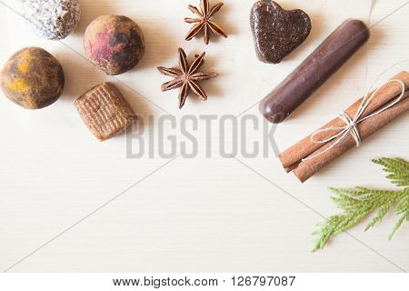 Raw Candies Made Of Date Fruit,nuts, Hibiscus,curry,cocoa,coconut Decorated With Cinnamon Sticks,car