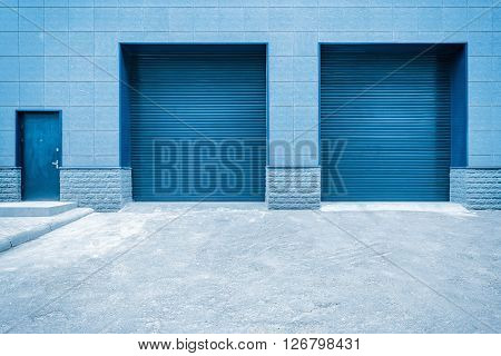 Metal blue gates and door of the shop storage.
