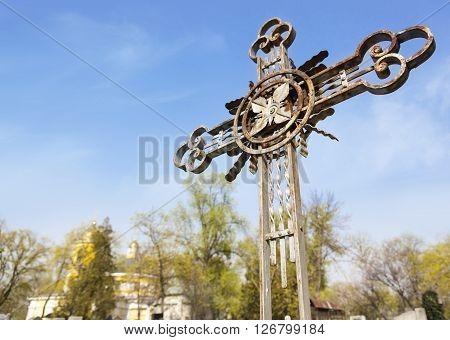 Old rusty metal Orthodox cross in the old cemetery