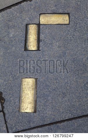 Brass cobbles marking the area where the historic Netherbow Port once stood on the Royal Mile in Edinburgh Scotland.