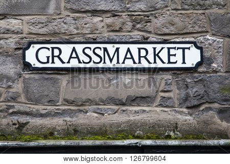 A street sign for Grassmarket in the historic city of Edinburgh Scotland.