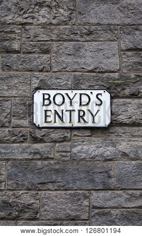 The street sign for Boyds Entry in the city of Edinburgh Scotland. It was on this site in the 18th Century where the Boyds Inn public house once stood and where Dr. Samuel Johnson first arrived in the city. poster