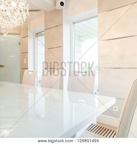 Cristal chandelier in bright dining room interior