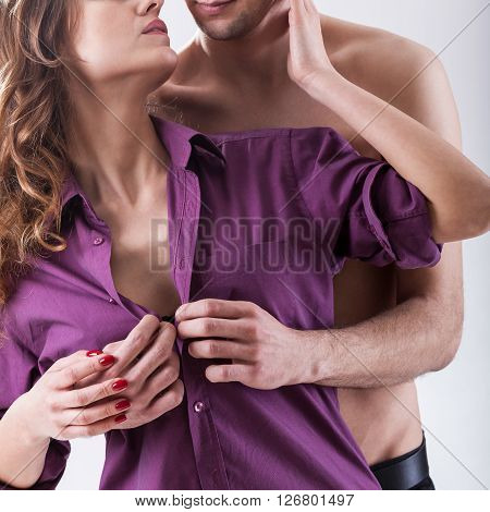 Vertical view of a husband undressing wife