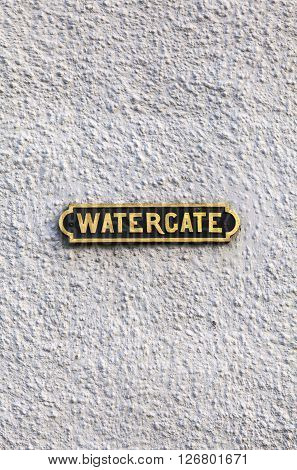 A street sign for Watergate in Edinburgh Scotland. The location gets its name from a medieval gateway that controlled traffic in and out of the area.