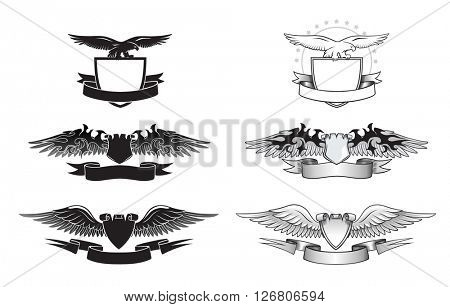 Set of black and white winged insignias