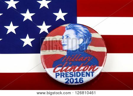 LONDON UK - MARCH 3RD 2016: A Hillary Clinton 2016 pin badge over the US flag symbolizing her campaign to become the next President of the United States 3rd March 2016.