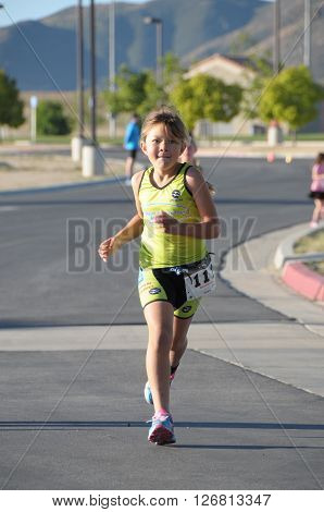 Hemet California/USA-April 17 2016:kid running in the Diamond Valley Triathlon