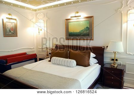 Side, ANTALYA, TURKEY - JUNE 02, 2015: Interior of Side, ANTALYA, TURKEY - JUNE 02, 2015: Interior of bedroom in white tones in high class hotel Ali Bey Resort, Turkey.