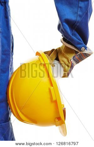 Hand of worker with yellow hardhat helmet