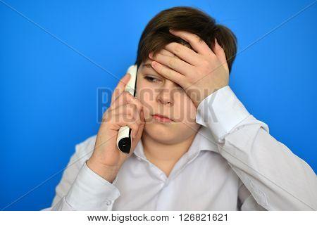 Upset teenage boy talking by a radiotelephony