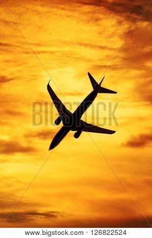 Sunset silhouette of passenger aircraft