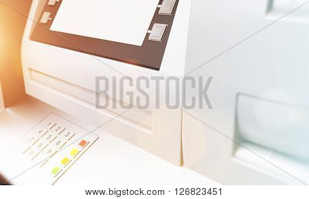 Closeup of ATM machine with blank display. Sideview. Toned image. Mock up 3D Rendering