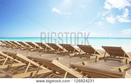 Rows of wooden chaise longues at the beach. 3D Rendering