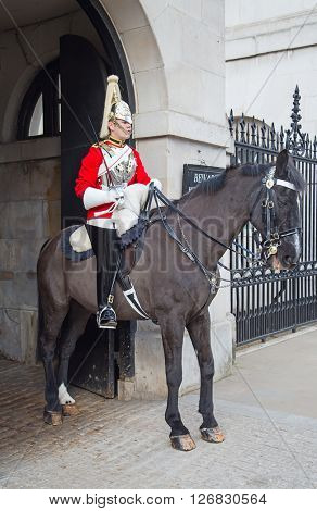 WINDSOR - APRIL 17: Unidentified man on the horse, guard protecting entrance to the Whitehall palace on April 17, 2016 in London, United Kingdom.