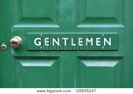 Gentlemen toilet sign on green victorian door
