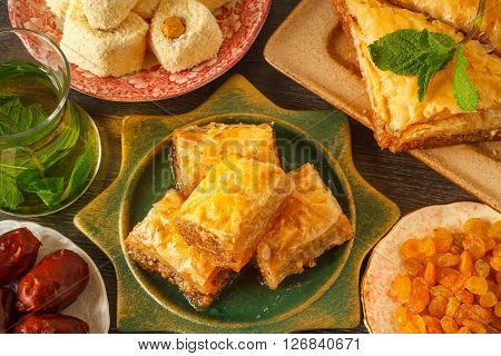 Baklava, kataif and other turkish traditional sweets with fresh mint tea