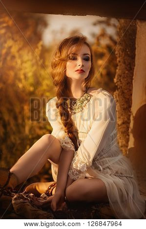 Portrait of beautiful young girl with makeup in fashion clothes