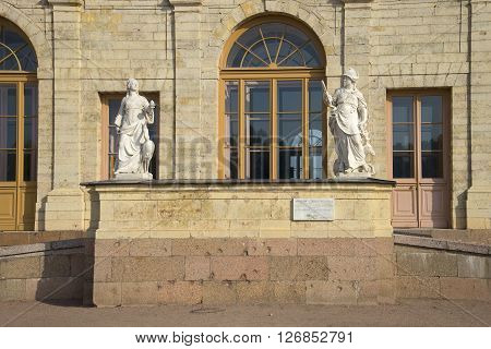 LENINGRAD REGION, RUSSIA - SEPTEMBER 24, 2015: Porch with two ancient sculptures. A large fragment of the Gatchina Palace. The landmark of Gatchina, Leningrad region, Russia
