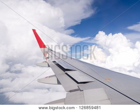 Beautiful view of airplane flying above clouds. Beautiful view took from the airplane. (Selective focus)