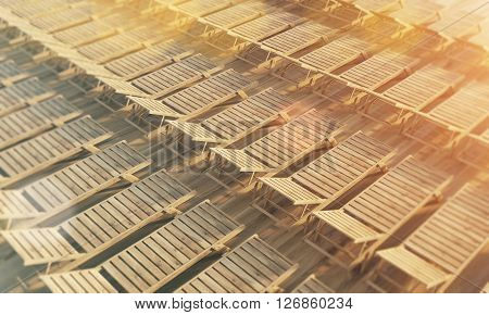 Rows of wooden chaise longues. Filtered. Topview 3D Rendering