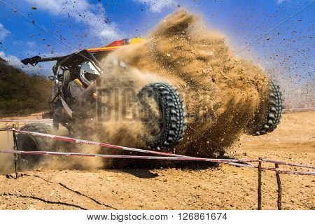 Buggy car splashed dust in off-road competition