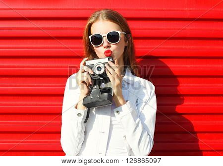 Pretty Cool Woman With Retro Camera Over Red Background