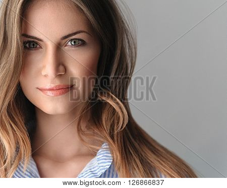 Portrait Of A Beautiful Young Woman With Perfect Skin And Beautiful Hair Closeup