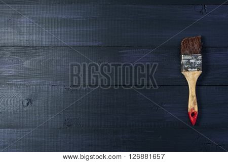 Old paintbrush on wooden background, horizontal view