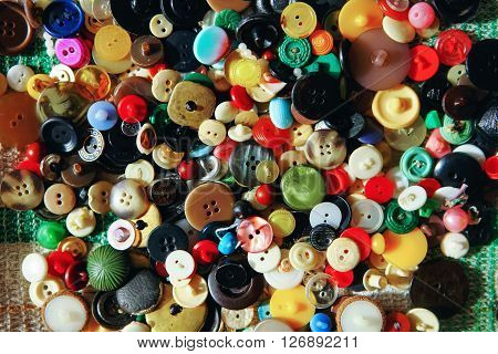 The buttons sewing close up a background.