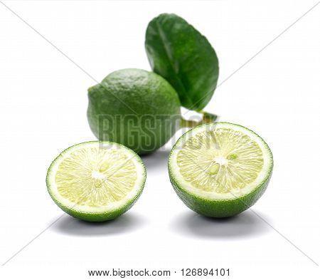 Green Lemons Lemons cut pieces isolated on white background.